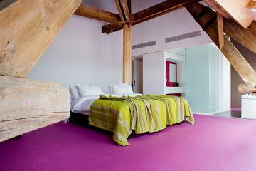 Slaapkamer hotel Eburon Belgie